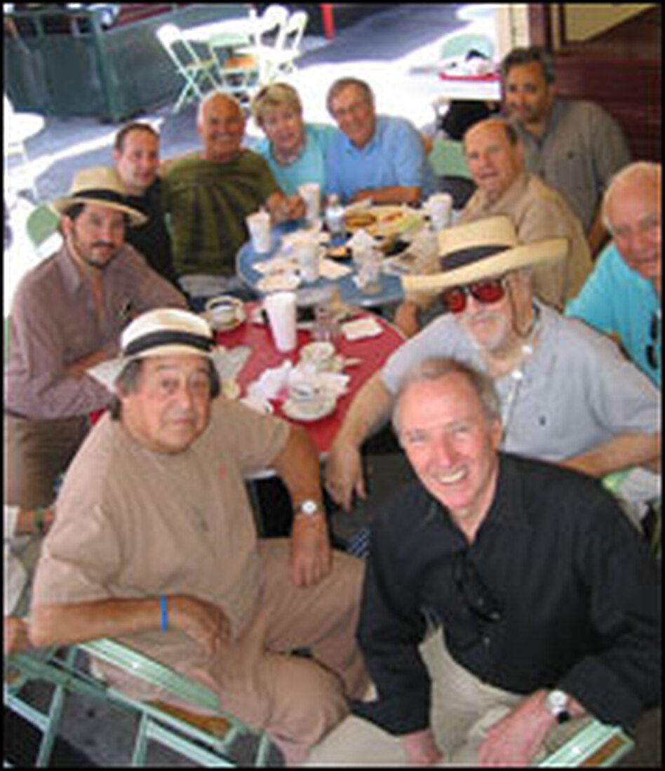 Joe Wambaugh (front center) visits Hollywood veterans, including producer Paul Mazursky (left) at Hollywood's legendary Farmer's Market. They meet every morning to kibitz. Wambaugh has incorporated these people into his books.