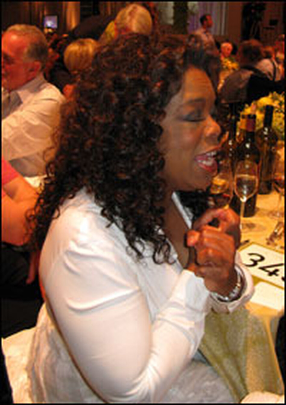 Oprah attends the Napa Valley Wine Auction.