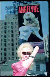 Angelyne poses with billboard in 1987