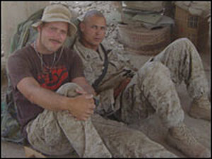 Evan Wright and Sgt. Antonio J. Espera kill time