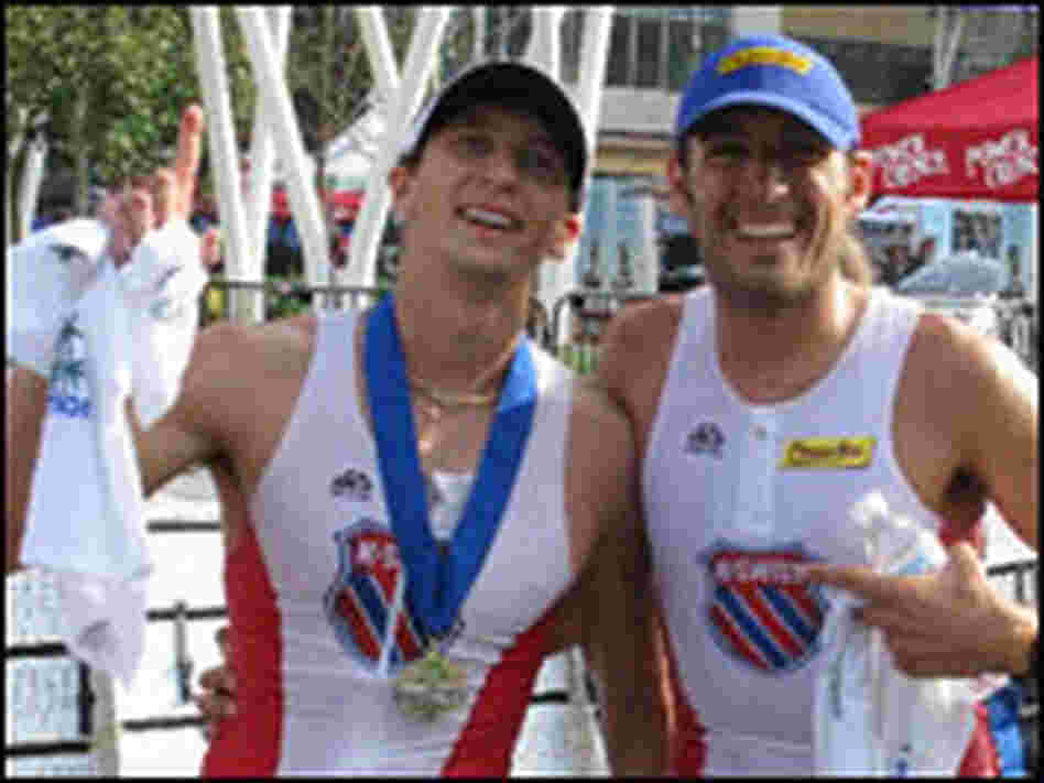 Athlete and training guide celebrate successful triathlon.