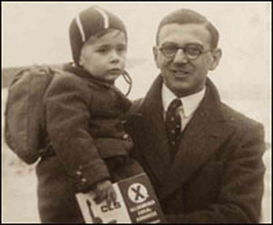 Nicholas Winton holds a child in the Prague train station in 1939.