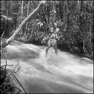 Schultes stands in a stream.