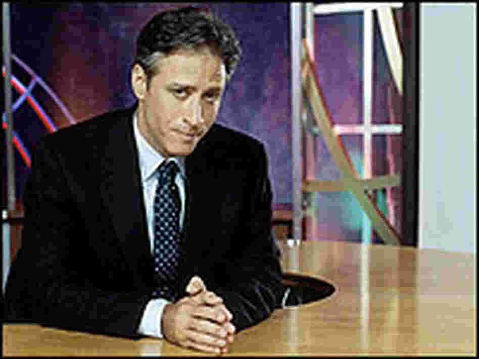 Jon Stewart at his anchor desk.