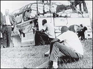 Freedom Riders Jimmy McDonald, left, and Hank Thomas and regular passenger Roberta Holmes sit in fro