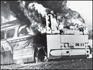 A 'Freedom Bus' in flames, six miles southwest of Anniston, Ala.,