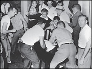 Ku Klux Klansmen beat black bystander George Webb in the Birmingham Trailways station, May 14, 1961.