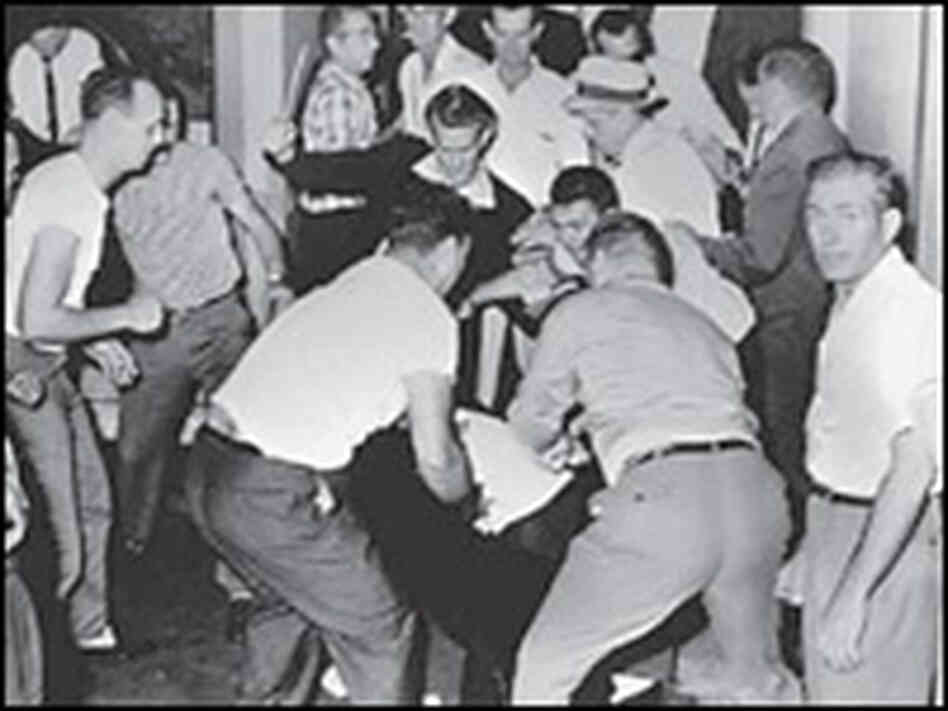 Ku Klux Klansmen beat African-American bystander George Webb in a Birmingham bus station, May 1961.