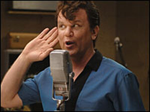 John C. Reilly at a microphone