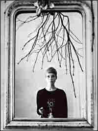 Astrid Kirchherr, shooting a self-portrait in the mirror