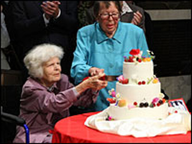 Del Martin, left, cuts the cake with her wife Phyllis Lyon at their June wedding. Martin died Aug. 27; the two were together for 55 years.