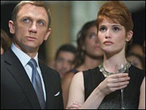 Daniel Craig as James Bond and Gemma Arterton as Strawberry Fields