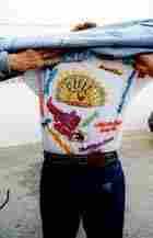 Sam Phillips shows off his Sun Studio T-shirt in Memphis in 1999.