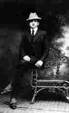 Portrait of Lector Joacquita de la Llana, crossing his legs and sitting on a chair.