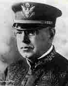 John Phillip Sousa in a peaked military hat.