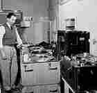 Jack Mullin in 1950 with two large machines used to record ABC's Bing Crosby Show.