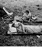 Marika and her mother lie on their cots and record tape in Kenya in 1968.
