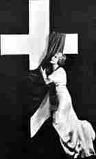 Sister Aimee in front of a cross during a pageant held in Los Angeles in 1935.