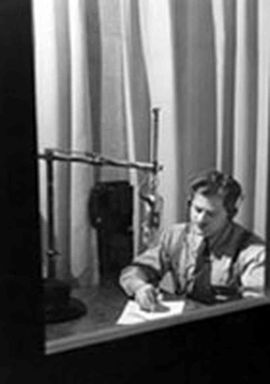 Norman Corwin in a sound studio, narrating his One World Flight series in 1947.