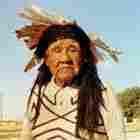 Emmett Van Fleet in a painted sweater and headress. Parker, Arizona.
