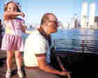Charles Traub looks across the water toward the world trade center