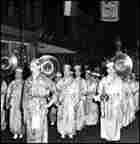 The band performs in a Chinatown New Year's parade, circa 1940.