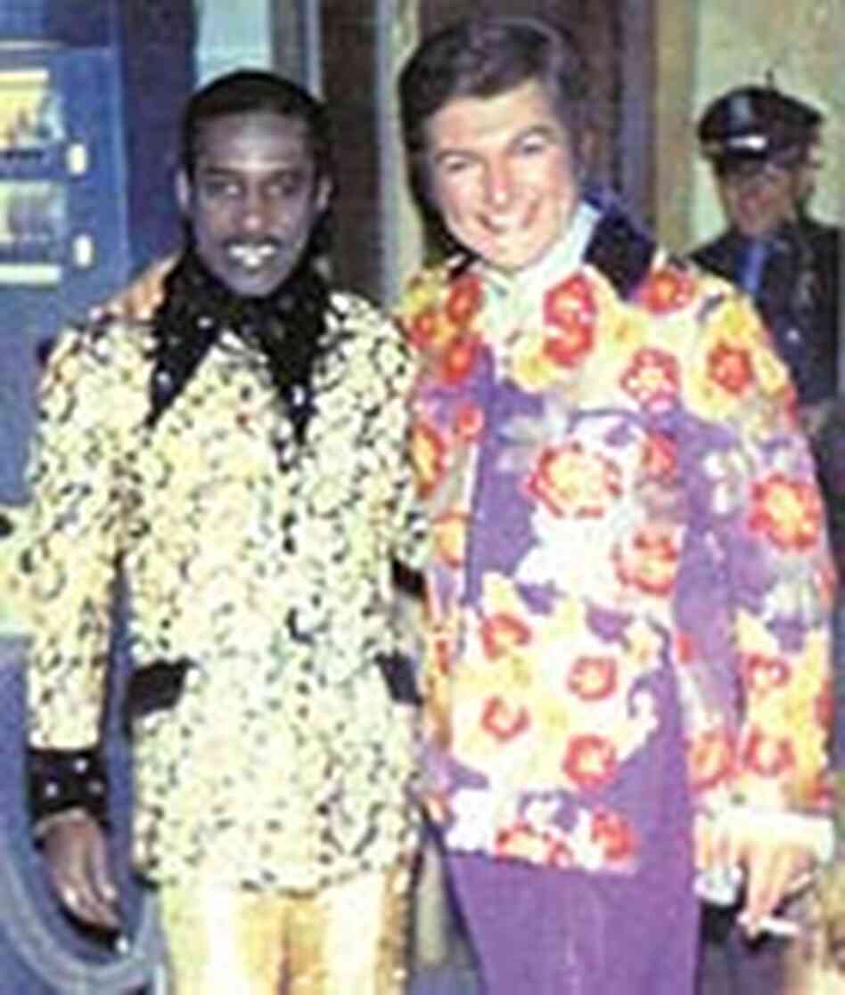 Hugh Borde, leader of the Esso Trinidad Tripoli Steelband, and Liberace, circa 1970.