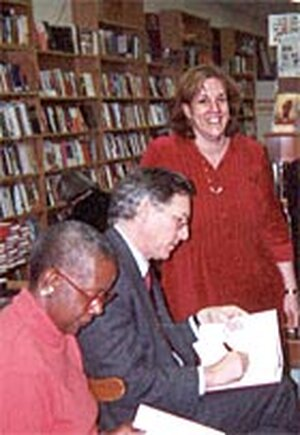 Rona Brinlee, standing, with authors Dorothy J. Gaiter and John Brecher at the Book Mark.