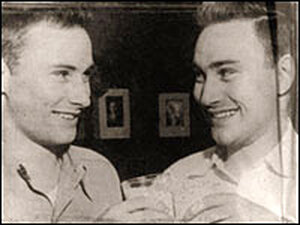 Ronald Herrick (left) and his identical twin Richard toast their good health.