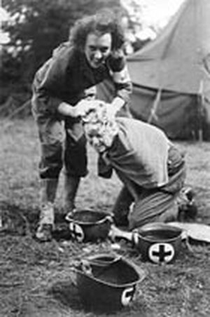 Fellow combat nurse Laura Ball washes Kate Nolan's hair at a field hospital in France.