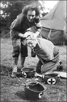 Fellow combat nurse Laura Ball washes Kate Nolan's hair at a field hospital in France in September 1944.