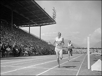 Roger Bannister breaks the tape in the o