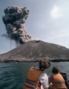 Tourists watch as smoke billows from a minor eruption of Anak Krakatau in 1995.