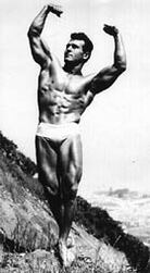 Jack LaLanne strikes a muscular pose.
