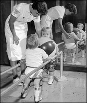 A physical therapist works with two polio-stricken children in the 1950s.