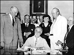 FDR signs the SSA bill. Credit: Library of Congress.