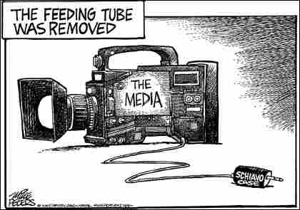 Peters-Media. Credit: Mike Peters, Dayton Daily News.