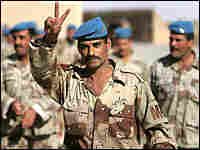 "An Iraqi soldier gives the ""V"" sign before voting for parliament. Credit: Bob Strong-Reuters."
