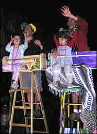 Kids -- and adults -- enjoy a little extra lift during a parade from a Mardi Gras ladder.
