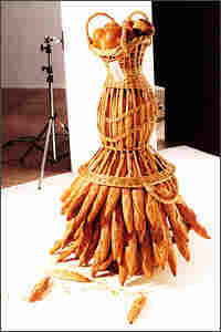 Here, a bread basket and baguettes bring to mind a woman wearing a skirt.
