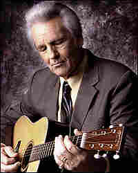 Del McCoury with guitar