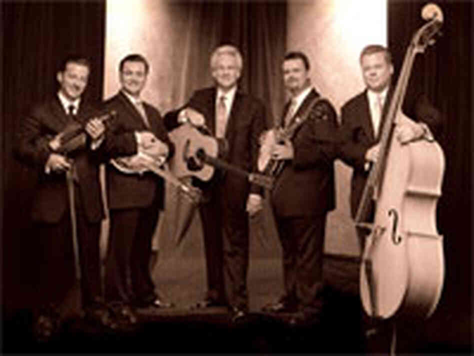 Del McCoury (center), with sons Ronnie and Rob and other band members.