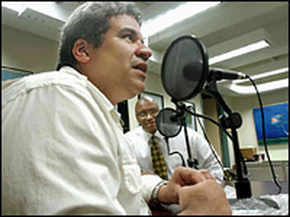 Frank Burgos (left), editorial page editor of the Philadelphia Daily News, and Eric Mayberry.