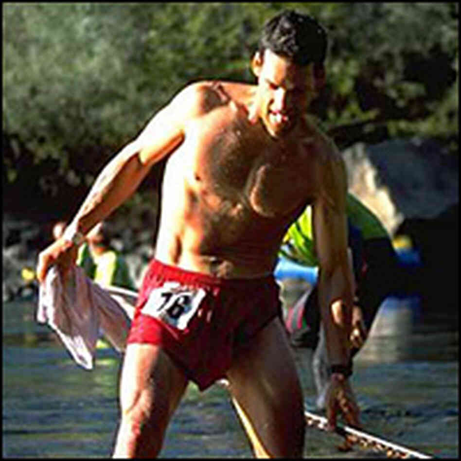 A river crossing isn't out of the ordinary during ultramarathons; Karnazes