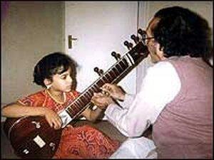 Anoushka Shankar gets sitar lessons from her father, Ravi Shankar, in 1989.