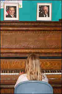 Abigail, 8, playing the Gold Creek School's piano. Credit: Neenah Ellis.