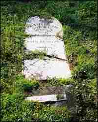 The broken headstone of Thaddeus Ames