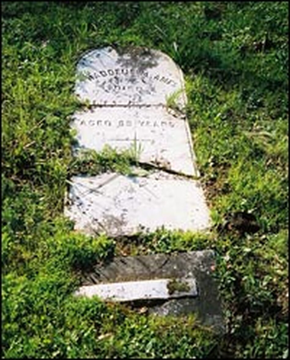 "The headstone of Thaddeus Ames, who died in 1876. Damaged and broken headstones give valuable ""shaking"" clues about earthquakes. This is a small cemetery near Graton, Calif., in Sonoma County, which endured some of the strongest shaking in the 1906 quake."