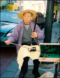 A musician on Grant Avenue in Chinatown.