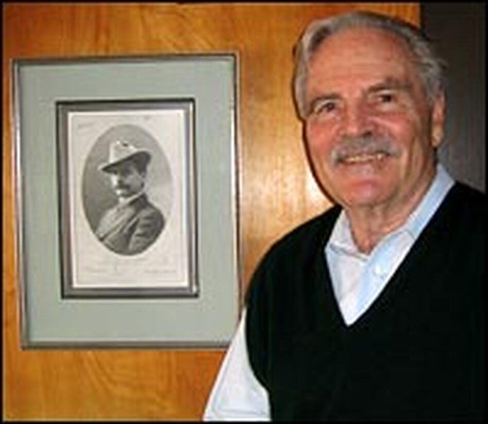 Richard Monaco stands near a photo of his grandfather, J.B. Monaco. In the 1970s, Richard Monaco uncovered steel cases behind sheetrock in the family home. Among the trove were dozens of J.B. Monaco's images and negatives of the 1906 fires.